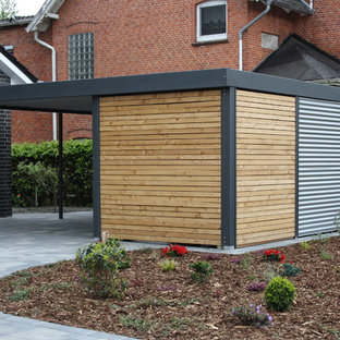 This is an example of a mid-sized contemporary detached one-car carport in Bremen.