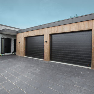 Example of a huge danish attached two-car garage design in Aalborg