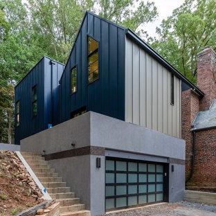 Inspiration för mellanstora moderna tillbyggda tvåbils garager och förråd