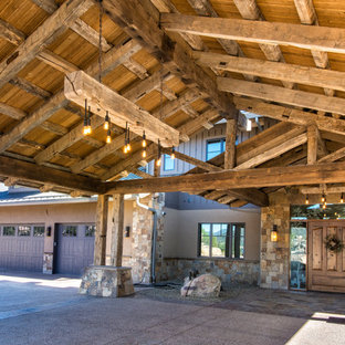 Example of a huge mountain style attached four-car carport design in Dallas