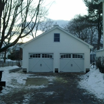24'x24' Detached garage with loft boasts carriage style doors and cupola