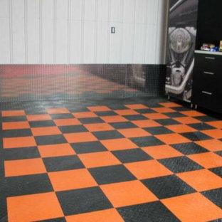 Example of a huge classic detached three-car garage design in Cedar Rapids