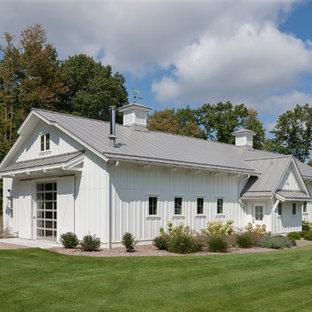Garage - huge farmhouse detached garage idea in Grand Rapids