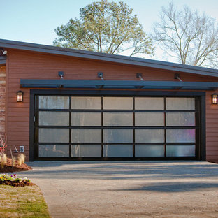 Inspiration for a large modern attached two-car garage remodel in Philadelphia