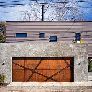 Exempel på en industriell tillbyggd tvåbils garage och förråd