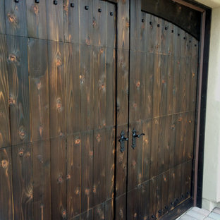 Garage - large rustic attached two-car garage idea in Phoenix