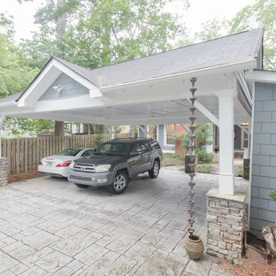 Photo of a traditional detached three-car carport in Atlanta.