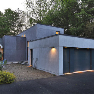 Example of a minimalist attached two-car garage design in Bridgeport