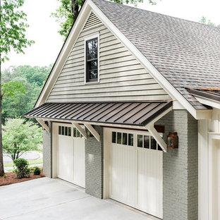 Immagine di un garage per due auto indipendente chic di medie dimensioni