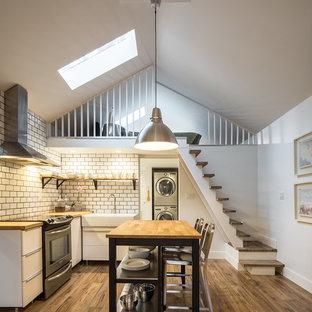 Design ideas for a medium sized contemporary detached single garage workshop in Toronto.