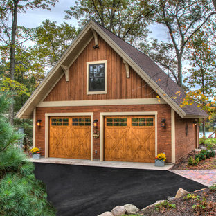 Garage - large rustic detached two-car garage idea in Minneapolis