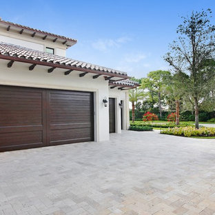 Huge tuscan attached four-car garage photo in Miami