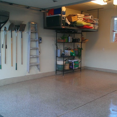 Mid-sized transitional attached two-car garage workshop photo in Denver