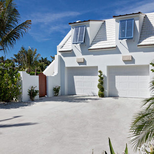 Inspiration for a tropical two-car garage remodel in Miami