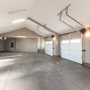 Example of a huge arts and crafts three-car garage design in Edmonton