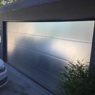 Brushed aluminum sectional roll up garage door