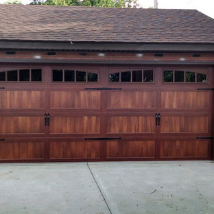 Example of a mid-sized classic detached two-car garage design in Cleveland