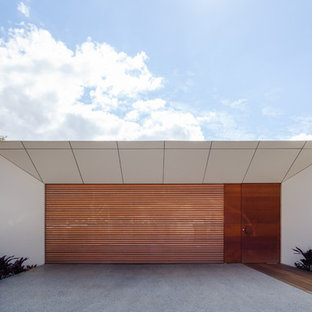 Photo of a modern attached two-car garage in Sydney.