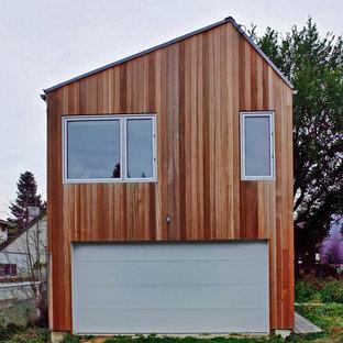 Inredning av ett nordiskt litet fristående tvåbils kontor, studio eller verkstad