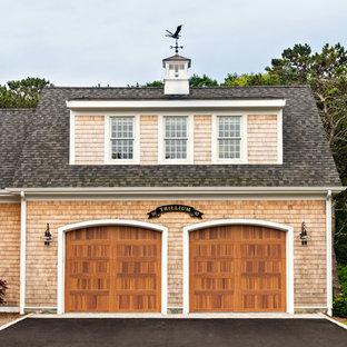 Example of a coastal two-car garage design in Boston