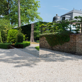 Inspiration for a large eclectic detached two-car carport remodel in Lille
