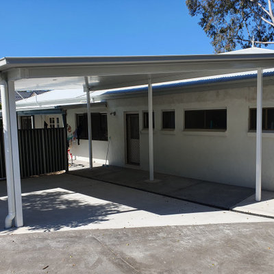 Example of a small trendy detached two-car carport design in Sunshine Coast