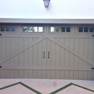 Mid-sized arts and crafts attached two-car garage photo in Orange County