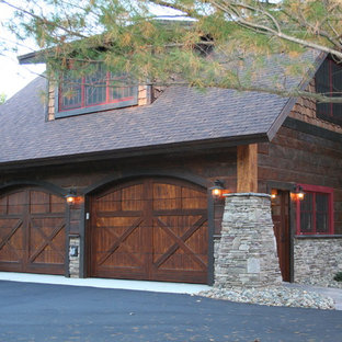 Garage - large rustic detached four-car garage idea in Minneapolis