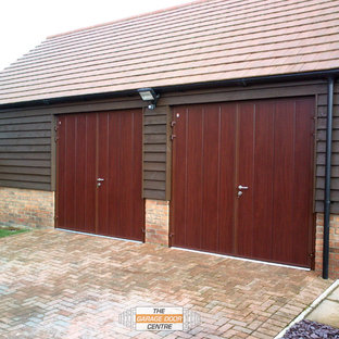 This is an example of a small contemporary detached double garage in Other.