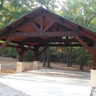 Large mountain style detached two-car carport photo in Dallas