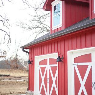 Garage workshop - huge cottage attached three-car garage workshop idea in Other