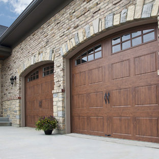 Example of a mid-sized classic attached two-car garage design in Cincinnati