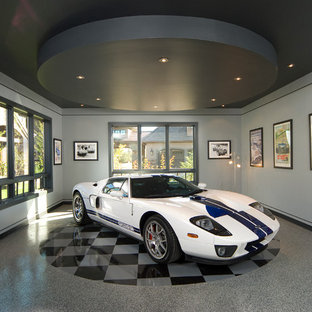 Example of a huge classic detached three-car garage workshop design in Other