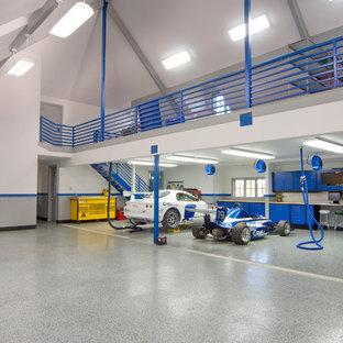 Inspiration for a huge timeless three-car garage workshop remodel in Other