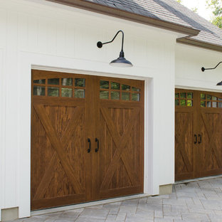 Example of a large farmhouse garage design in New York