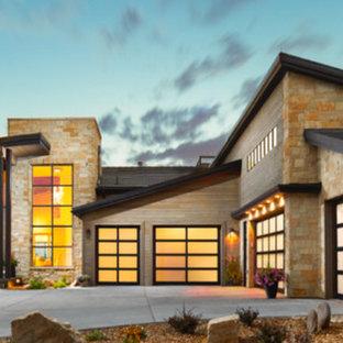Example of a huge trendy attached four-car garage design in Denver