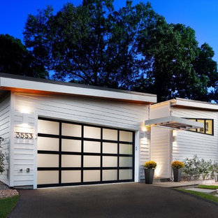Garage - mid-sized contemporary attached two-car garage idea in DC Metro