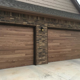 Garage - large contemporary attached three-car garage idea in Oklahoma City