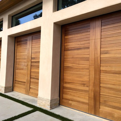 Inspiration for a large tropical attached three-car carport remodel in Orange County