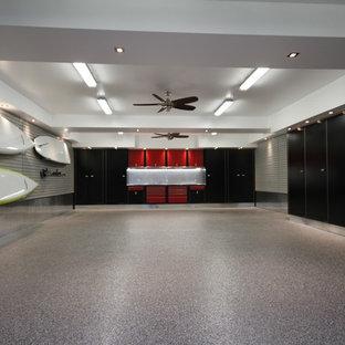 Garage - huge modern detached three-car garage idea in Toronto