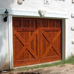 Cowart Door - Cowart Door - Custom Wood Garage Doors - Custom Wood-on-Steel garage door using Select Tight Knot Western Red Cedar and stained using the Sikkens Cetol finish installed in an eclectic garage.