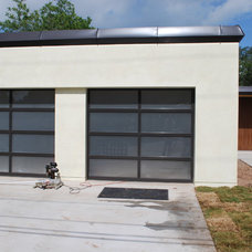 Contemporary Garage And Shed by Cowart Door Systems