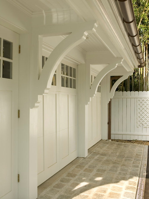 example of a large classic detached three car garage design in other - Garage Design Ideas