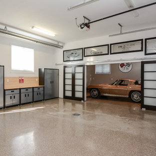 Contemporary garage in Toronto with three or more cars.