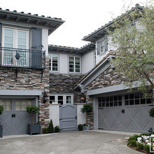 Custom French Door Architectural Shutters Atop A Iron Forged