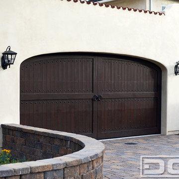 Custom-Made Spanish Mediterranean Garage Door Design With Deco Hardware