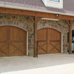 Custom Trim Carpentry - Custom wooden garage doors by Top Notch Construction