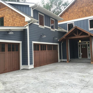 Inspiration for a mid-sized craftsman attached three-car garage remodel in Boise