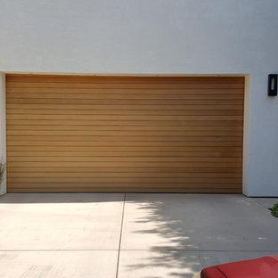 Idee per un garage per due auto connesso minimalista di medie dimensioni
