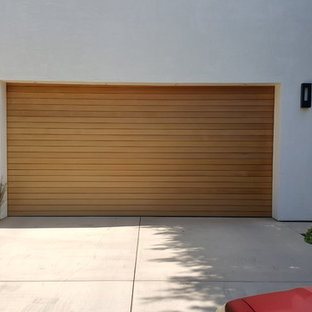 Example of a mid-sized minimalist attached two-car garage design in Los Angeles